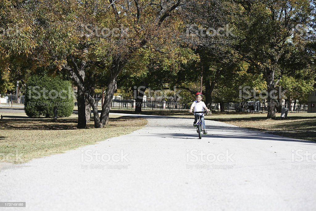Boy Riding His Bike With Helmet On At A Park royalty-free stock photo
