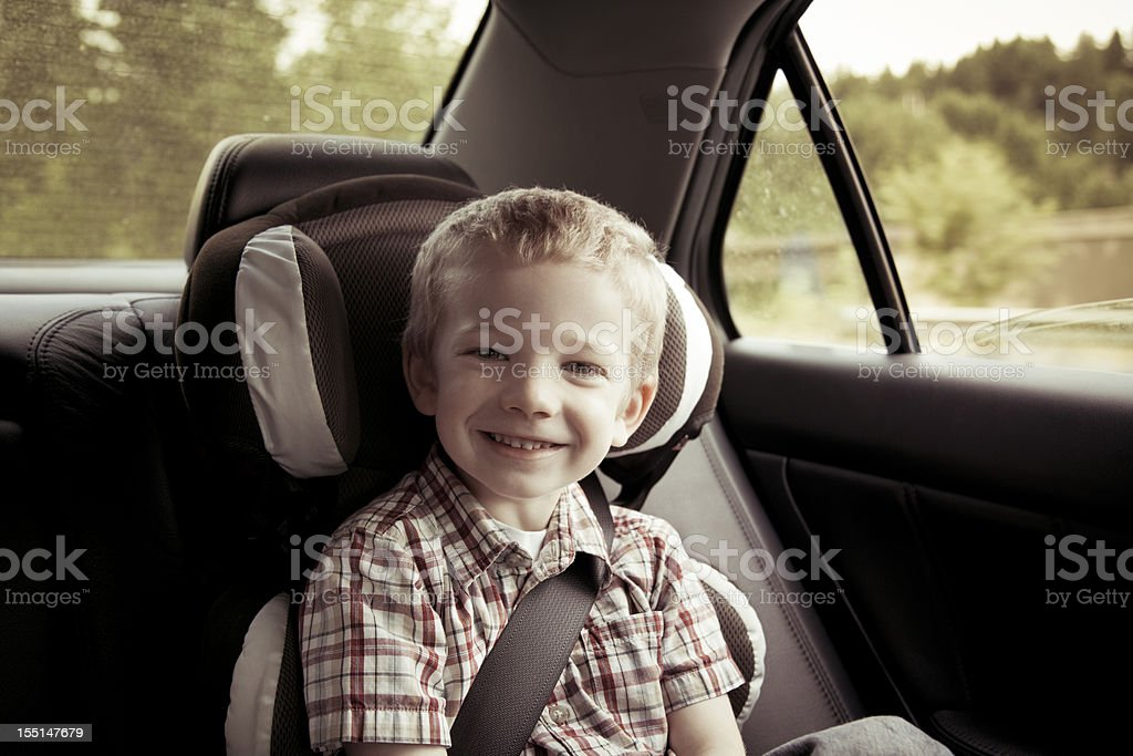 Boy riding in car with a big smile royalty-free stock photo