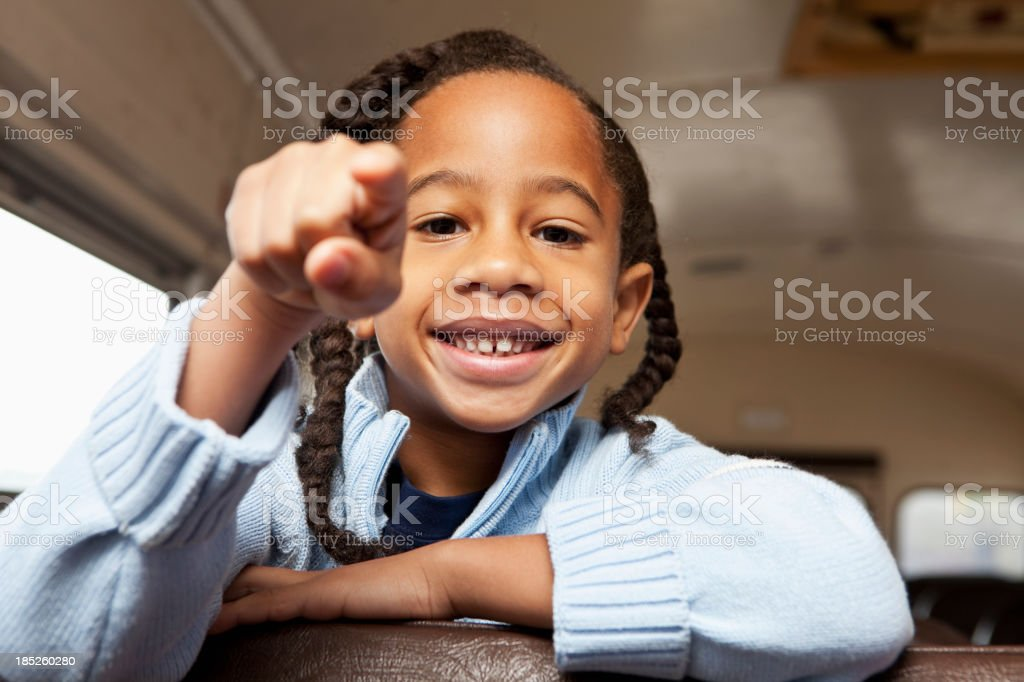 Boy riding school bus stock photo