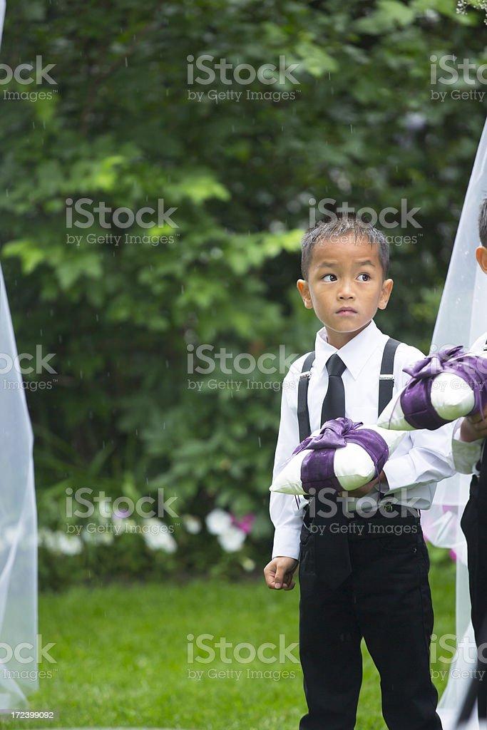 Boy ring bearer at wedding stock photo