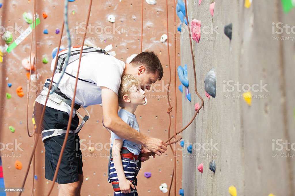 boy rock climbing stock photo