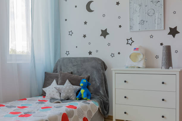boy room corner with bed - badewannenkissen stock-fotos und bilder