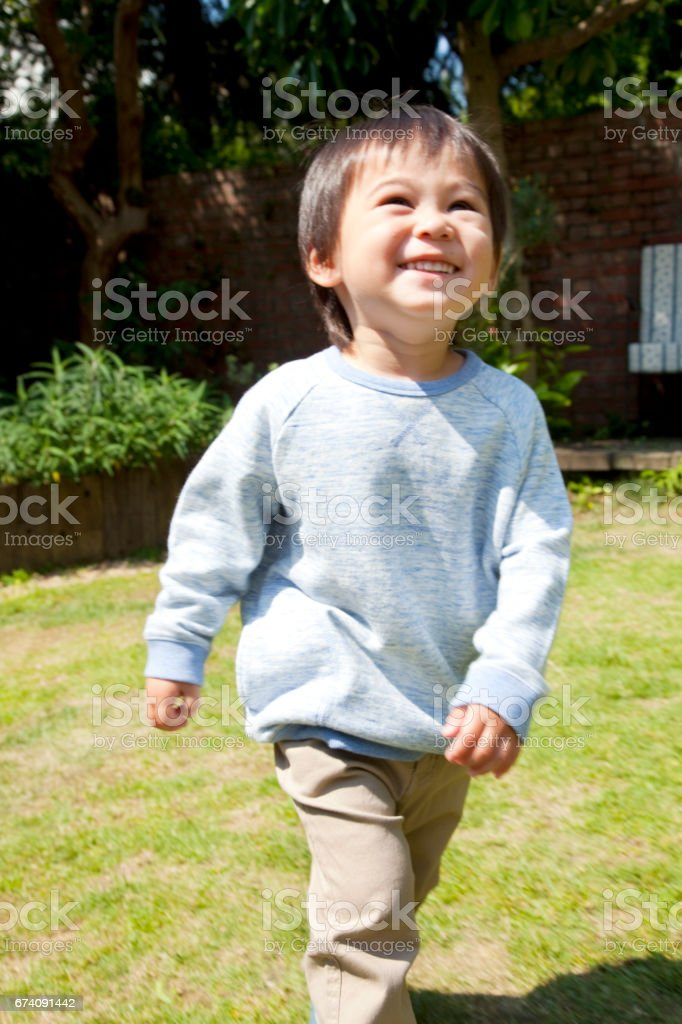 Boy running in Garden royalty-free stock photo