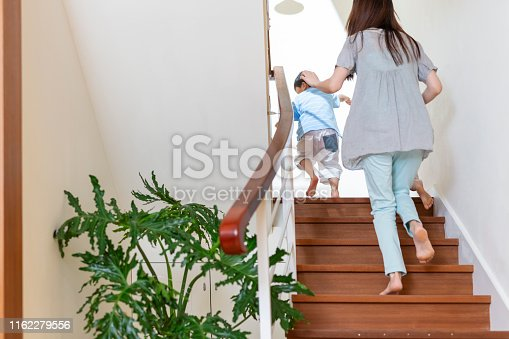 Boy Running Upstairs With His Mother