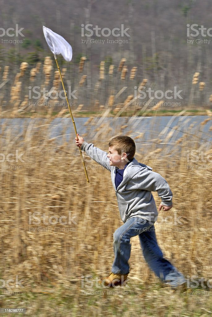 Boy Running with Net royalty-free stock photo
