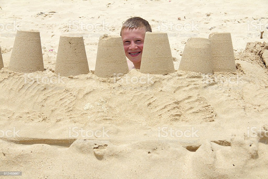 boy sandcastle stock photo