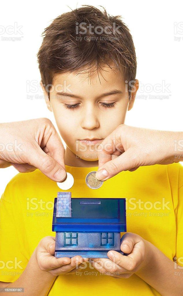 Boy saving money royalty-free stock photo