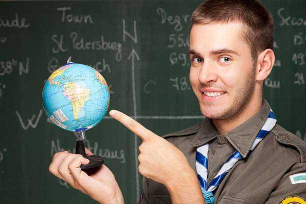 Boy scout choosing next travel destination stock photo