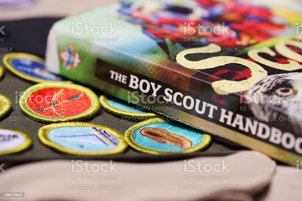 Boy Scout Handbook with Merit Badge Sash stock photo