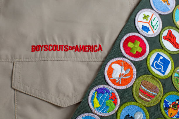 Boy Scout uniform and sash stock photo