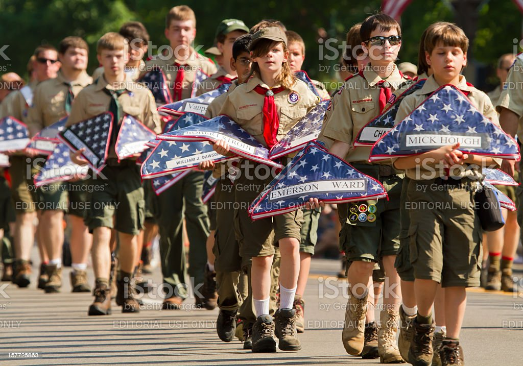 Boy Scouts Carrying Flags in Memorial Day Parade stock photo