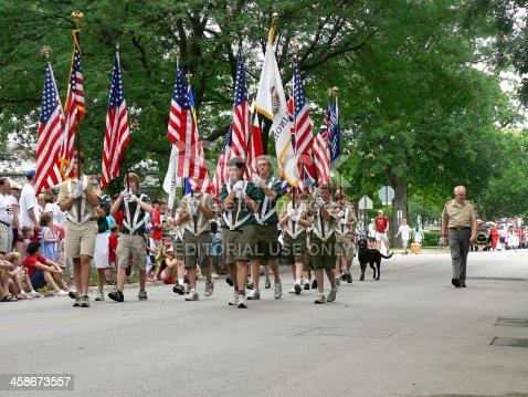 istock Boy Scouts marching in Fourth of July parade 458673557