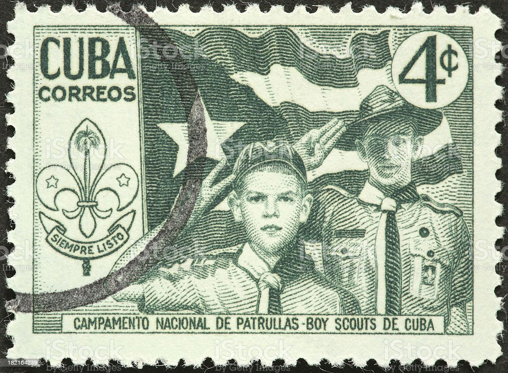 boy scouts on an old Cuban postage stamp stock photo