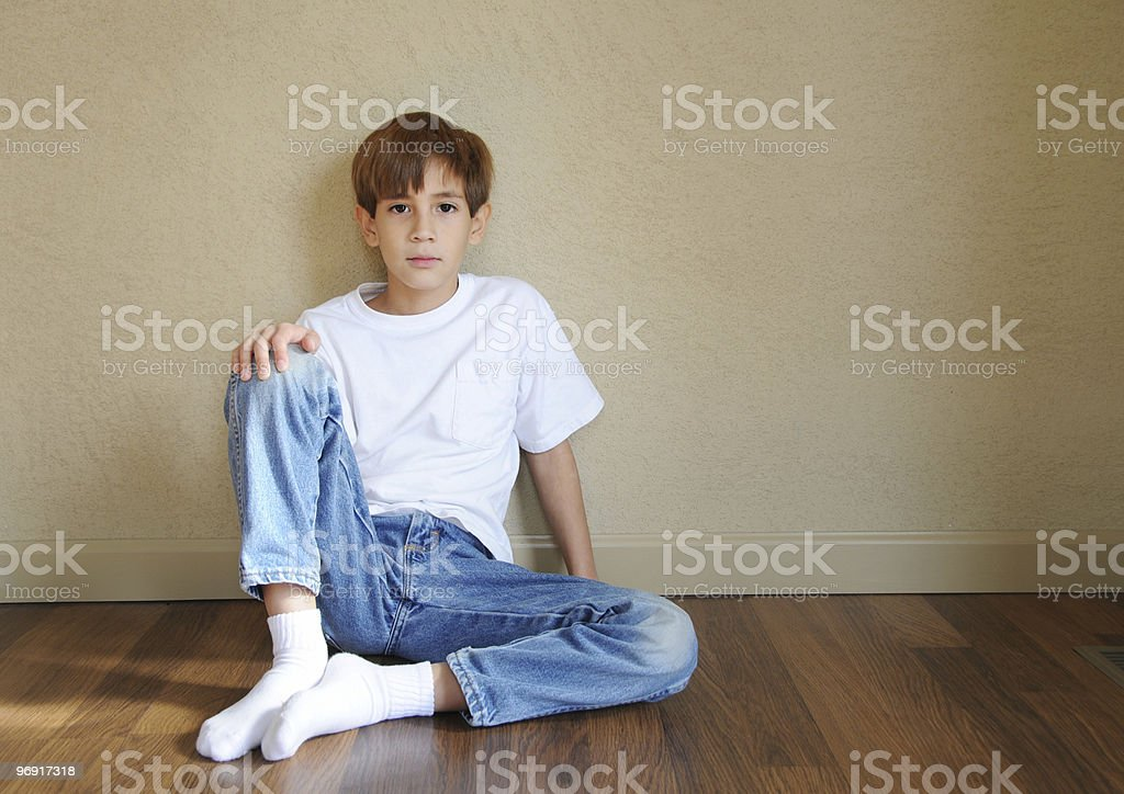 Boy seating royalty-free stock photo
