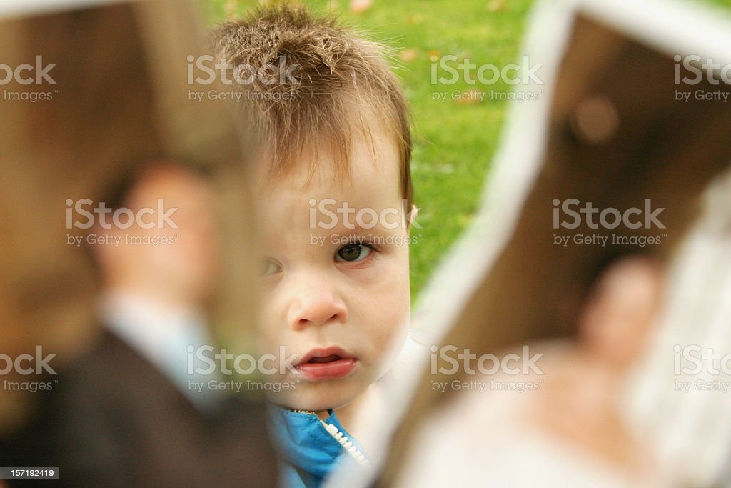 Boy separated by the figure of divorce royalty-free stock photo