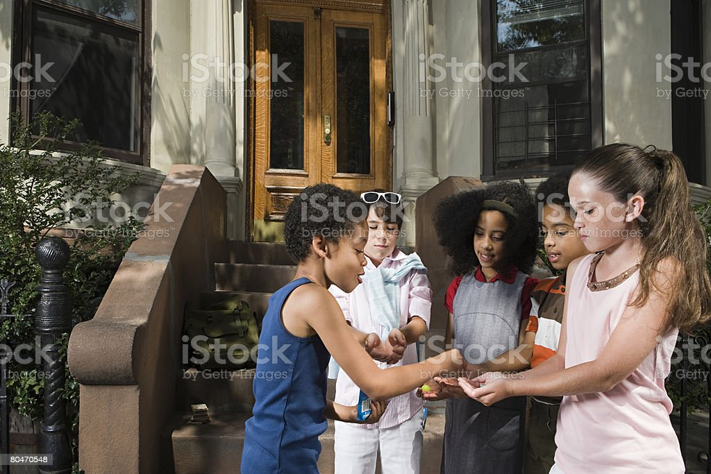 Boy sharing with friends royalty-free stock photo