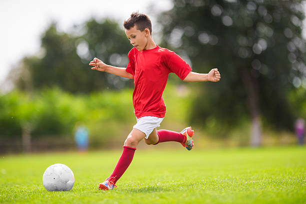 Boy Shooting at Goal stock photo