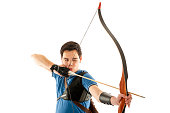 Boy with blue shirt aiming with bow and arrow