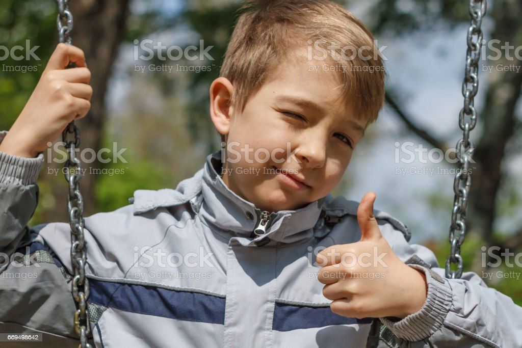 Boy showing ok sign stock photo