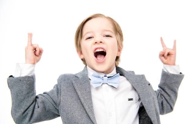 Boy showing rock sigh stock photo