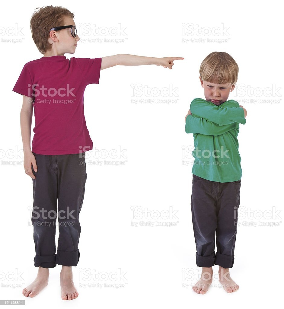 boy showing who is guilty stock photo