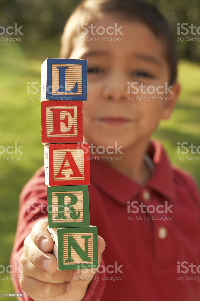 boy showing word 'learn' royalty-free stock photo