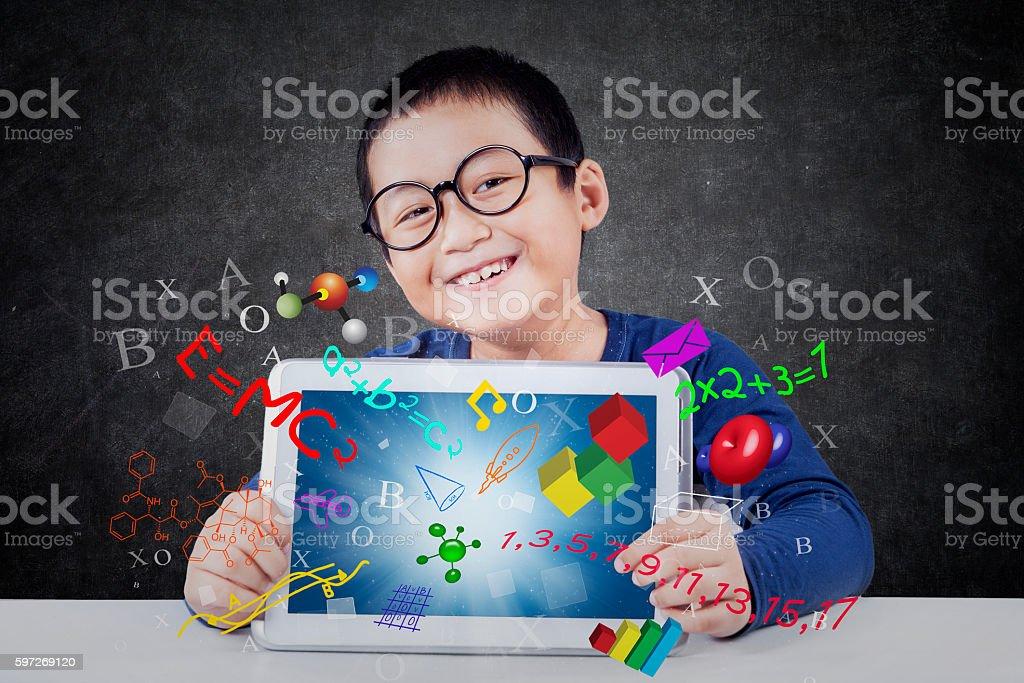 Boy shows tablet with formula Lizenzfreies stock-foto