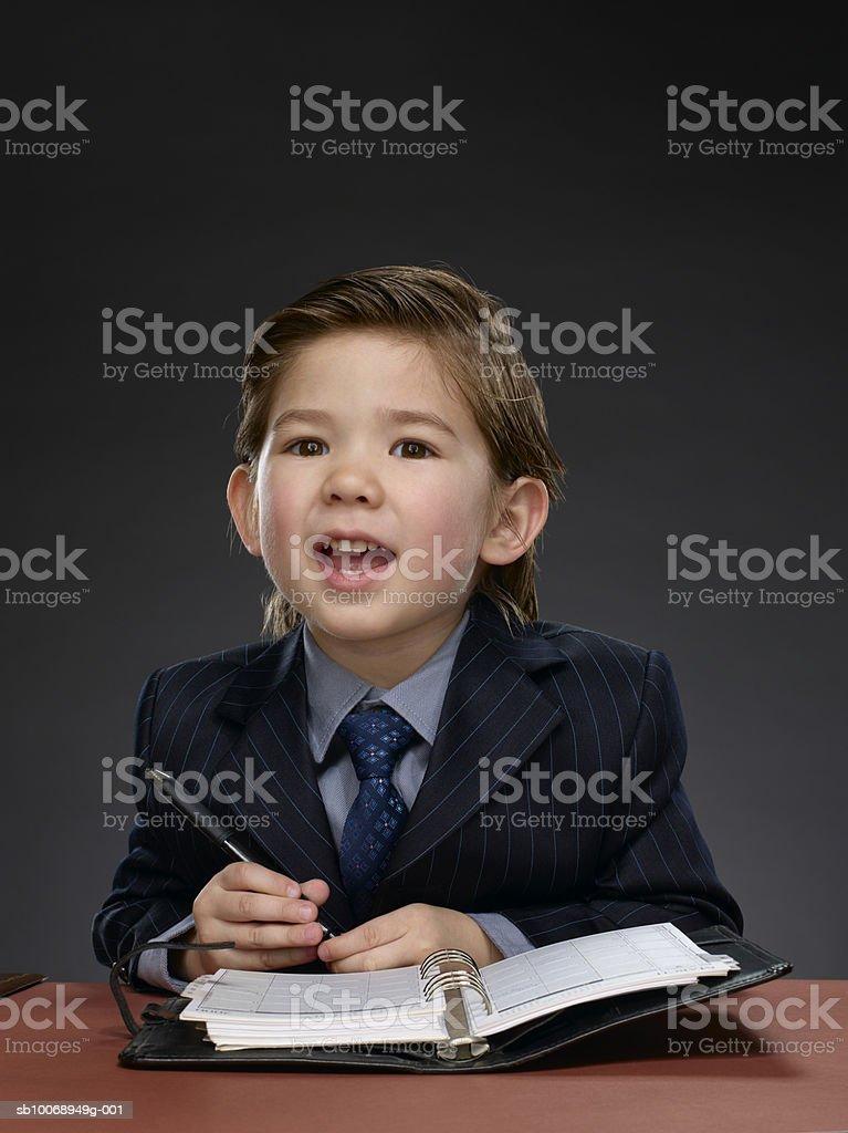 Boy (2-3) sitting at desk, portrait royalty-free stock photo