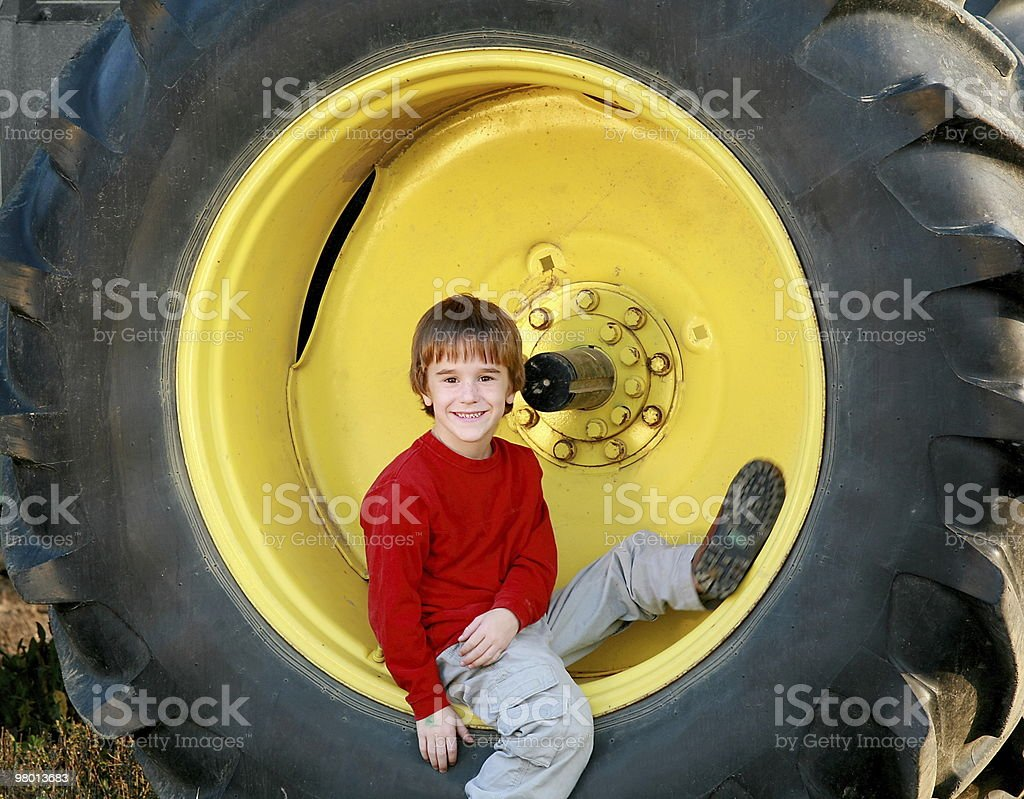 Boy Sitting in Tire royalty-free stock photo