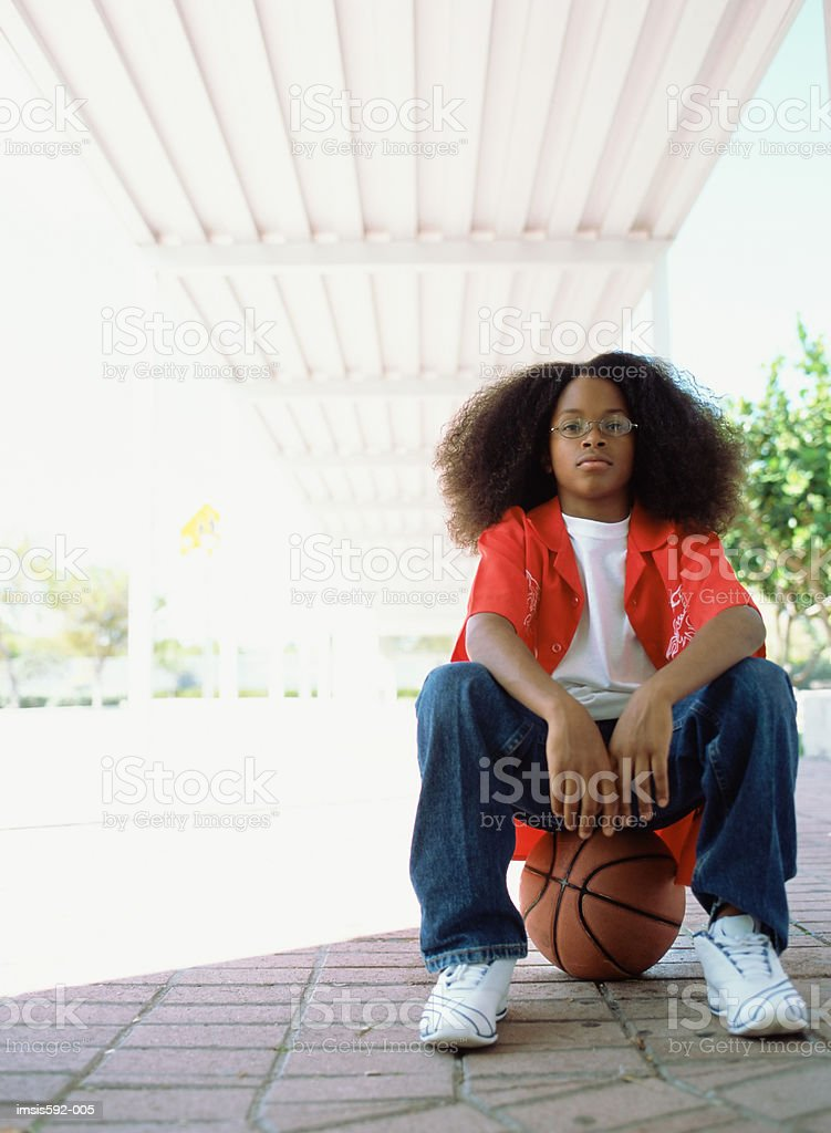 Boy sitting on basketball royalty-free 스톡 사진
