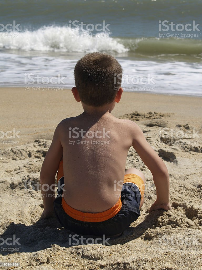 Boy Sitting on Beach royalty-free stock photo