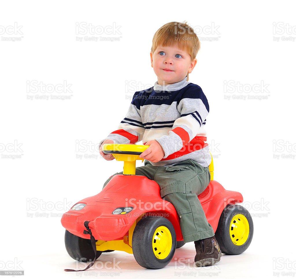 Boy sitting on car royalty-free stock photo