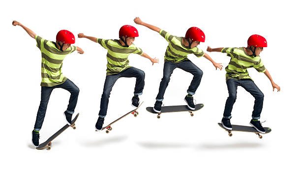 Boy Skateboarding on a White Background This is a series of four photos combined together to create a moving sequence of a 14 year old boy performing an ollie on a skateboard taken in the studio on a white background. sequential series stock pictures, royalty-free photos & images