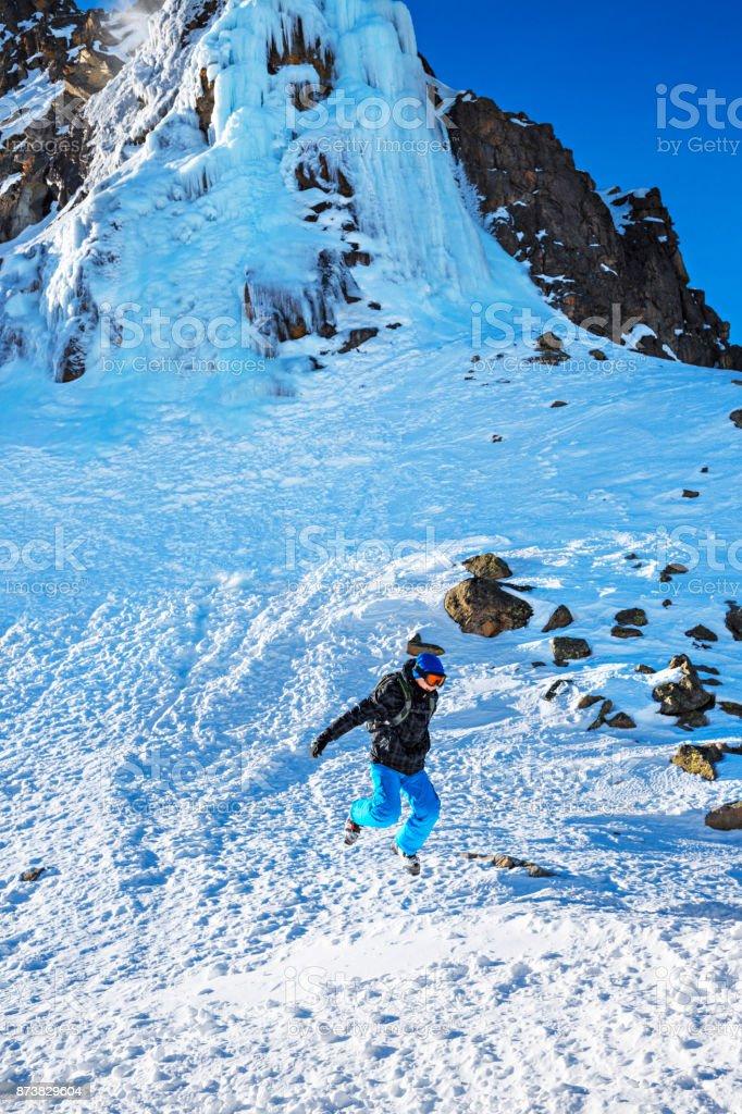 Boy skier playing in snow at ski resort Dolomites in Italy stock photo