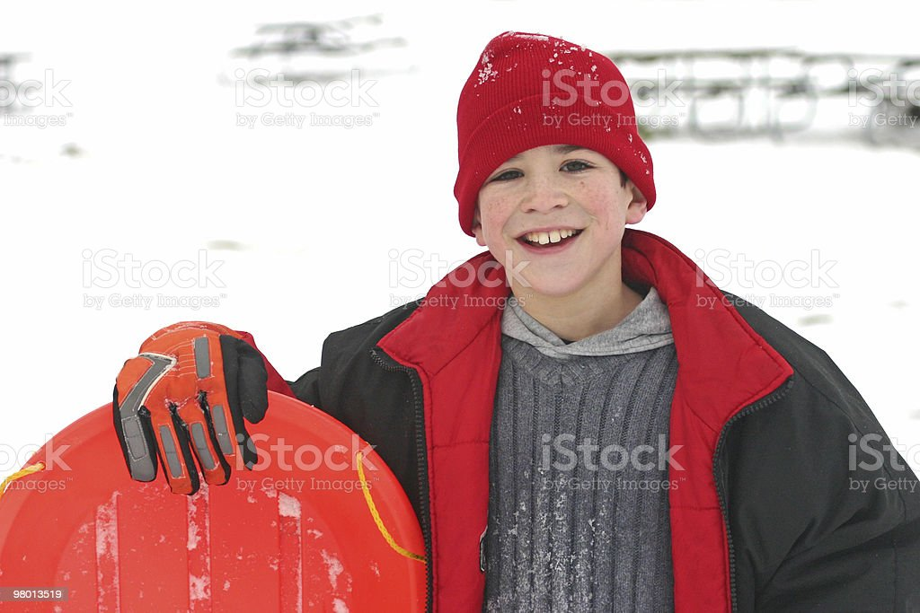 Boy Sledding royalty-free stock photo
