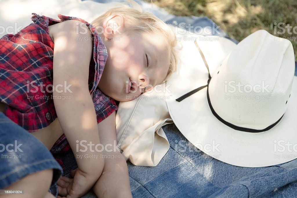 Boy Sleeping Next To His Cowboy Hat stock photo
