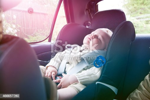 istock Boy sleeps in baby car seat on a road trip 466657280