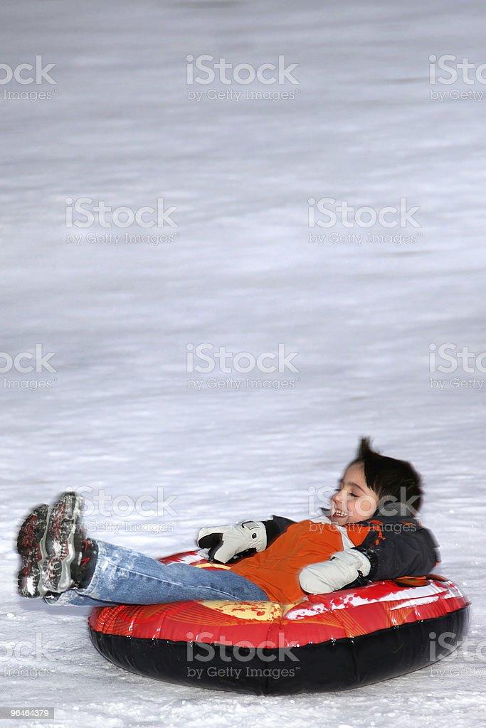 Boy Sliding Down Hill royalty-free stock photo