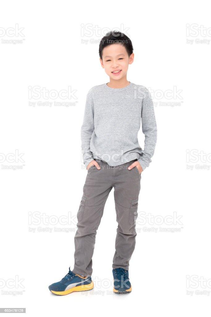 boy smiles over white background stock photo