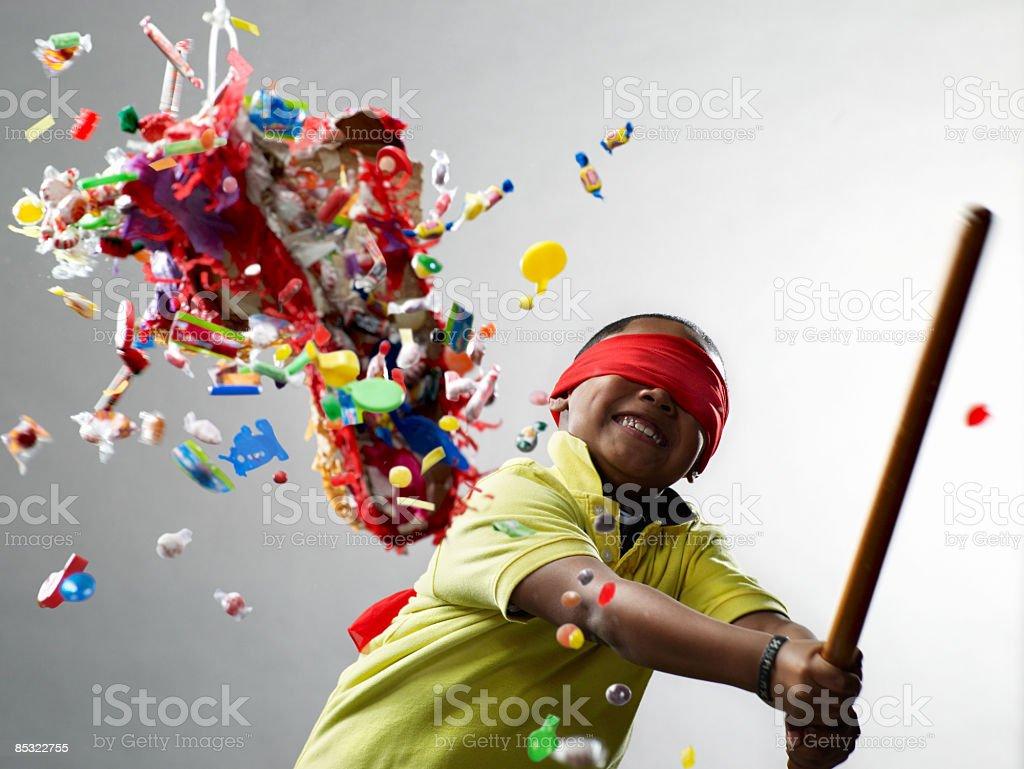 Boy smiling after hitting pinata royalty-free stock photo