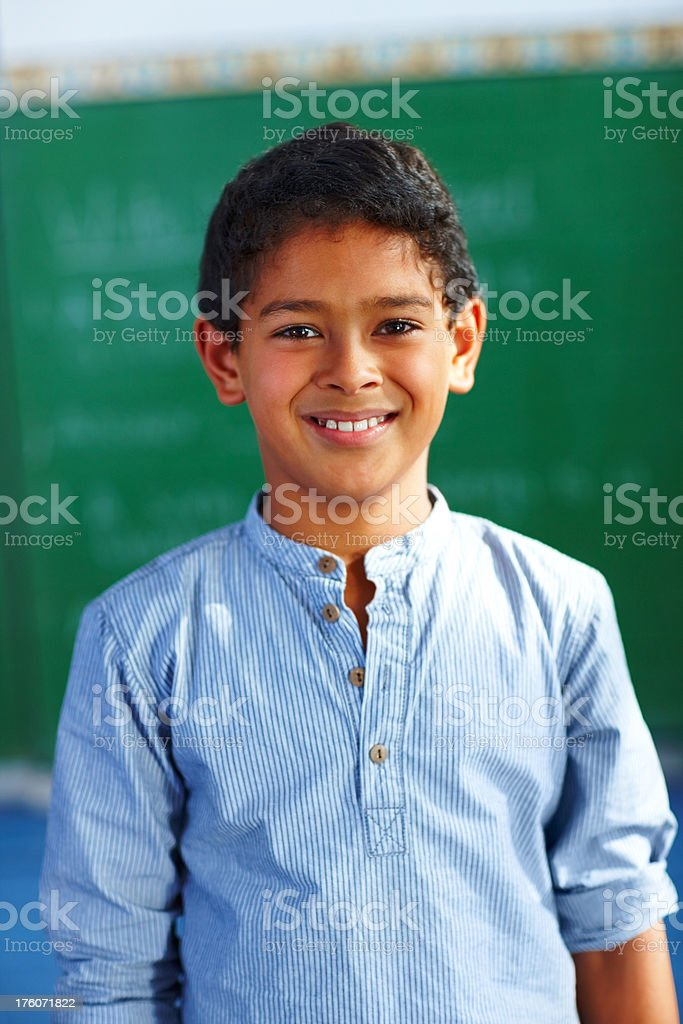 Boy smiling in the classroom royalty-free stock photo