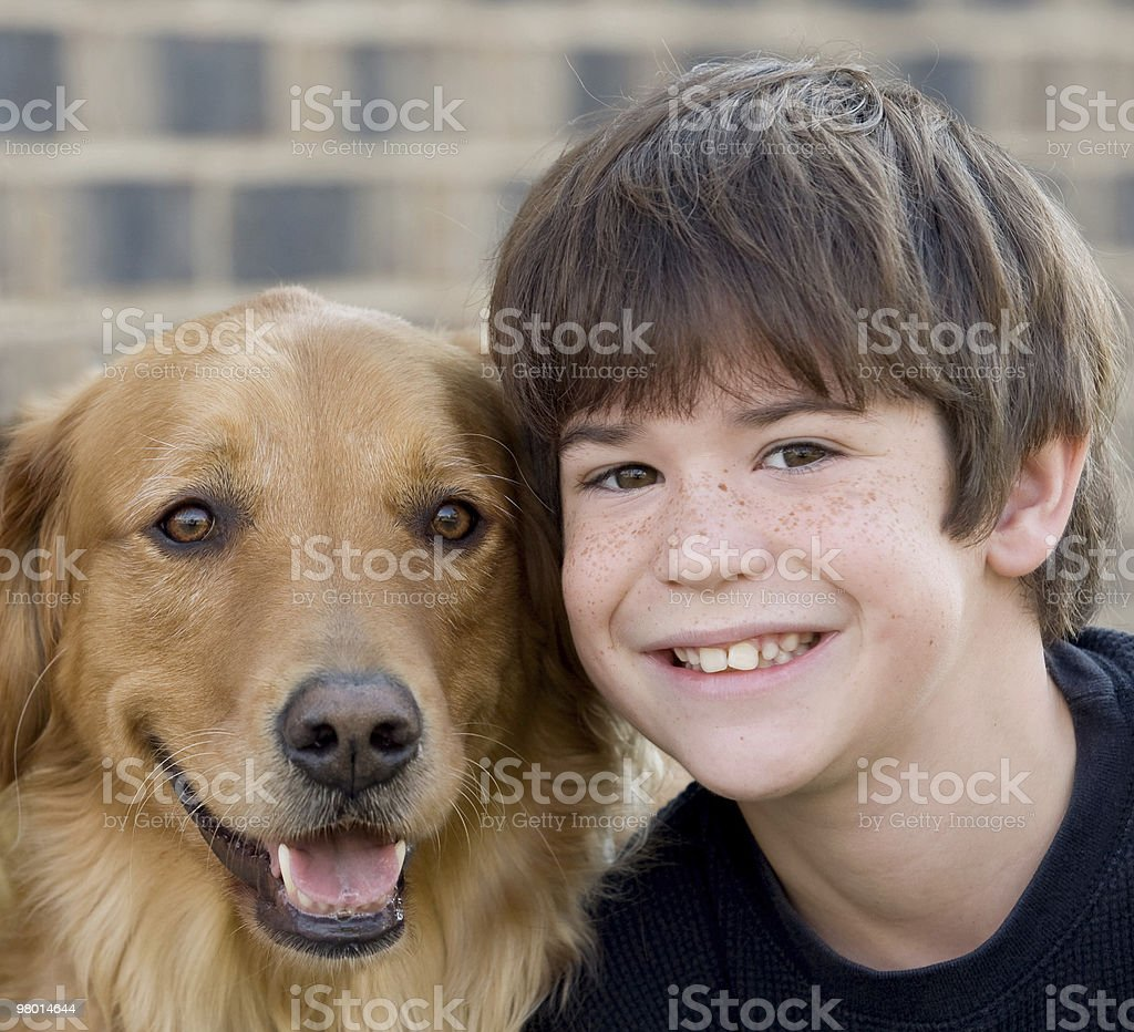 Boy Smiling With Dog royalty-free stock photo