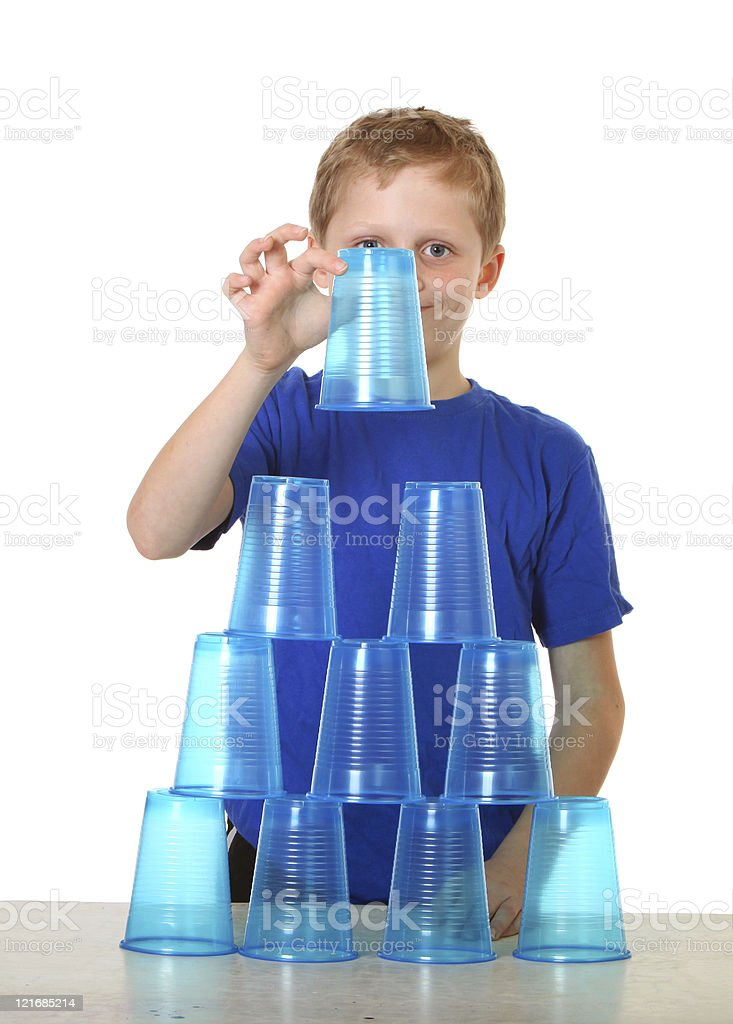 boy stacking cups royalty-free stock photo