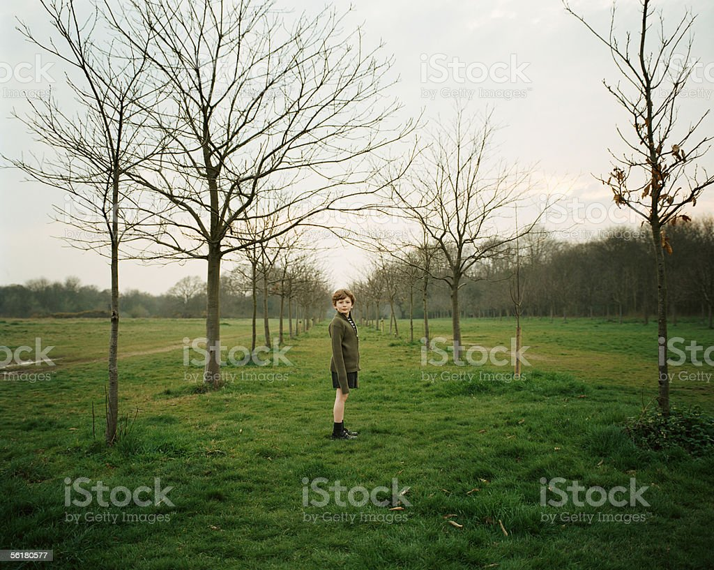 Boy standing in a field stock photo