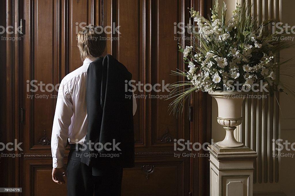 Boy standing in front of door royalty-free 스톡 사진