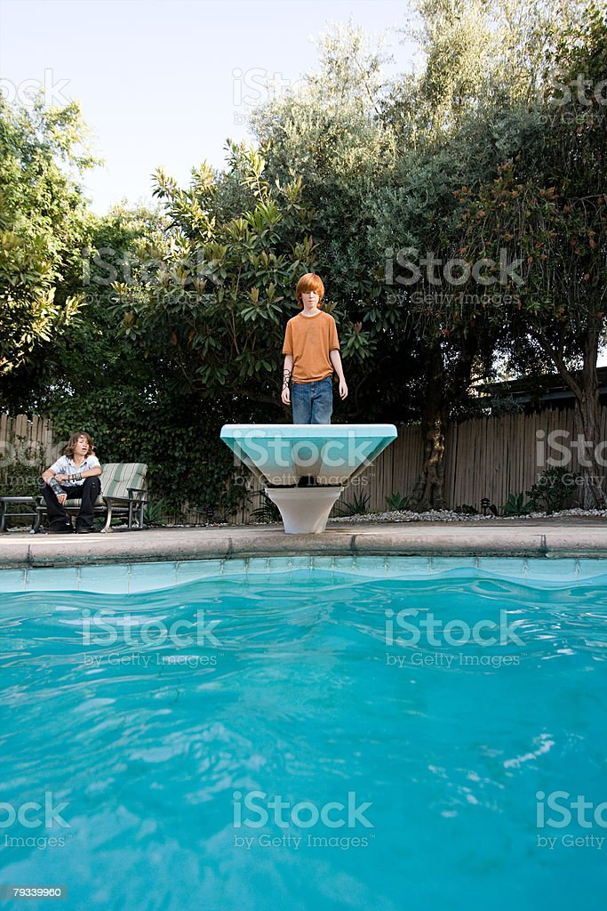 Boy standing on diving board royalty-free 스톡 사진