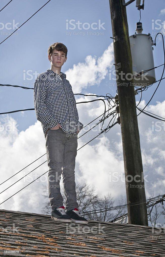 Boy standing on (Garage) Roof stock photo