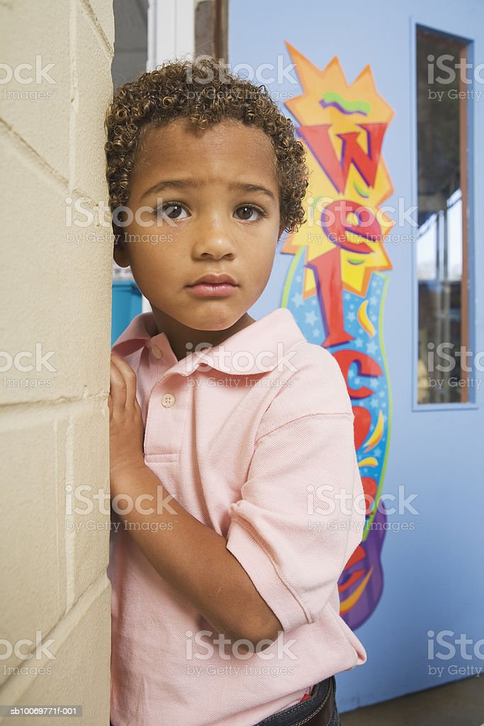 Boy (4-5) standing outside classroom royalty-free stock photo