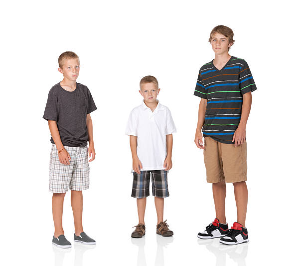 Boy standing with his brothers stock photo