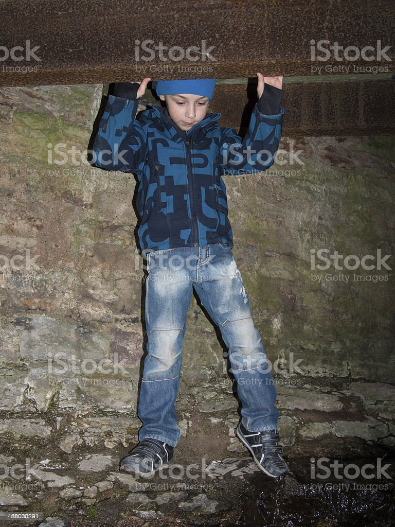 Boy stands in a cave royalty-free stock photo